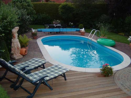 velký oválný zapuštěný bazén